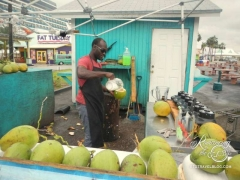 Freeport, Bahamas enterprising coconut drink salesman
