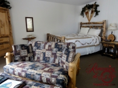 Our room at Fawn Valley Inn - Mountains, fishing and bears decor, nicely done with a small kitchen.