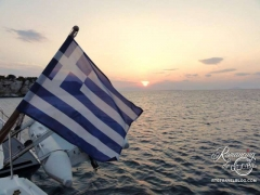 Greek flag at sunset