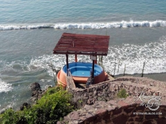 One of two cliffside hot tubs
