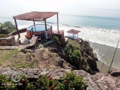 Two cliff-side hot tubs